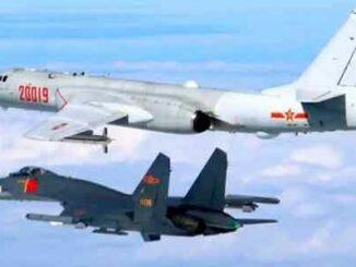 Bombardero H-6K y caza J-11chinos